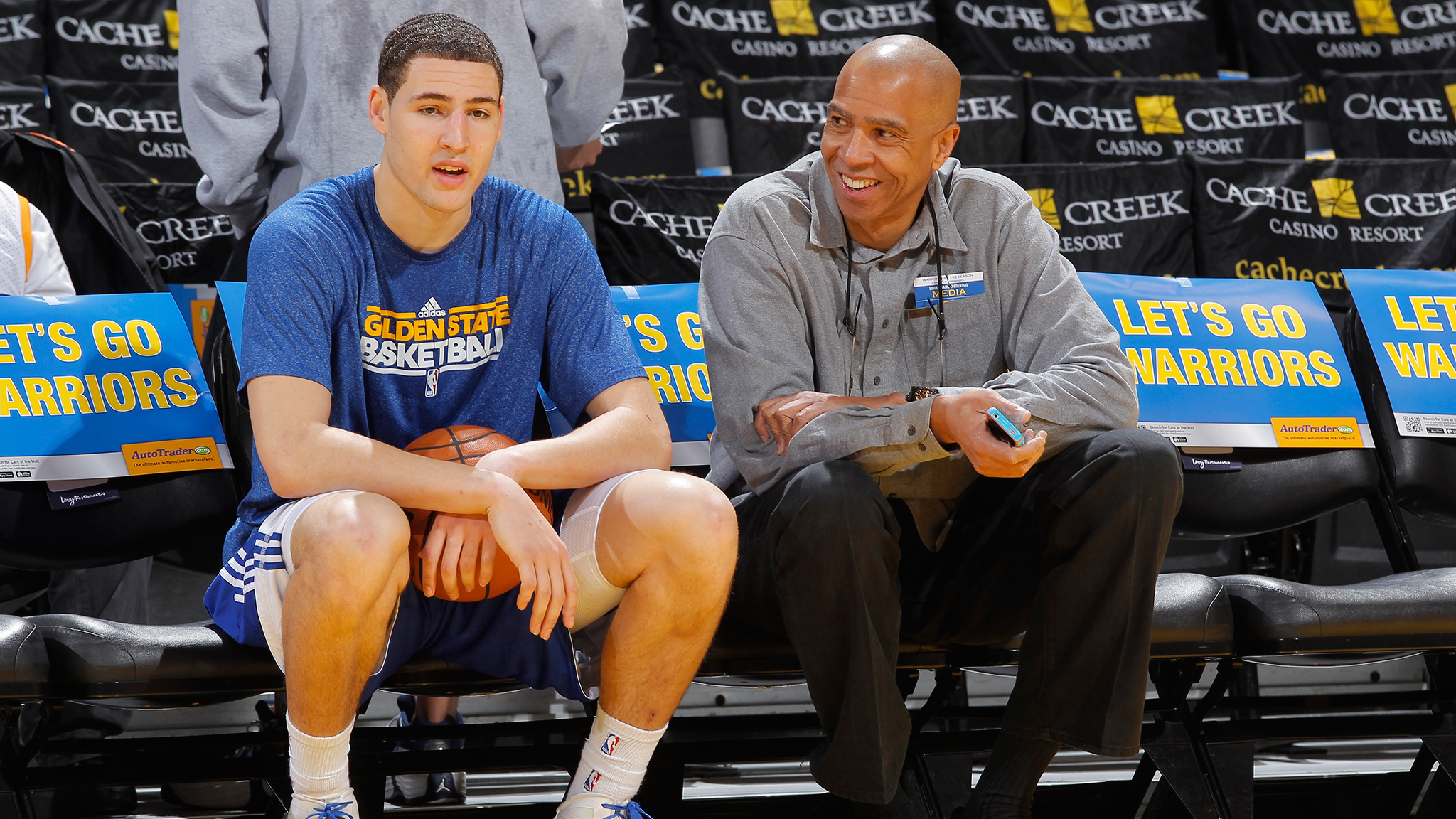 Klay Thompson of the Golden State Warriors talks to his father Mychal Thompson before a game against the Los Angeles Lakers in 2012. Mychal Thompson works as a Lakers commentator for ESPN 710 in Los Angeles and commentates on his son's performance on the court when the Warriors and Lakers play.