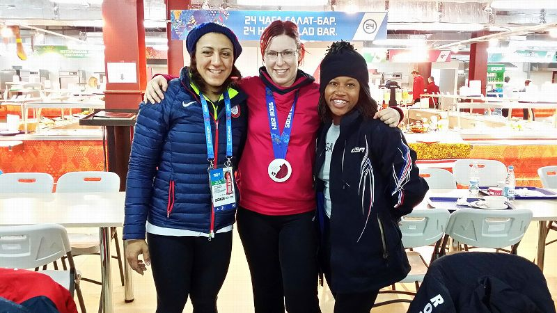 Elana Meyers, left, asked Romanian driver Maria Constatin, center, to wear her Olympic medal because of Constantin's help in an important training run before the Games.