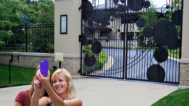 Even before LeBron James made it official, Cleveland fans were making themselves right at home outside his house.