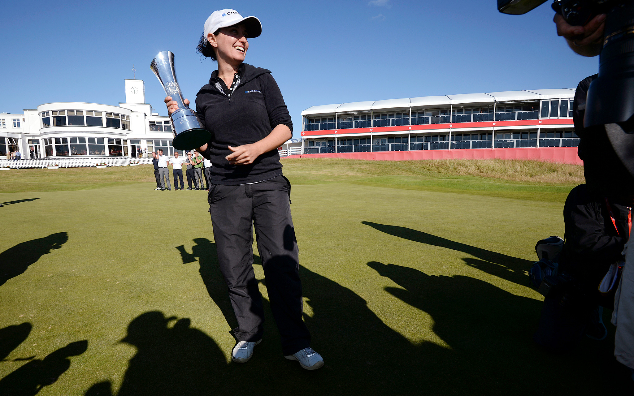 American Mo Martin poses for photographs after winning the Ricoh Women's British Open. Martin earned 474,575 -- she had 599,760 in career money when she arrived in England.
