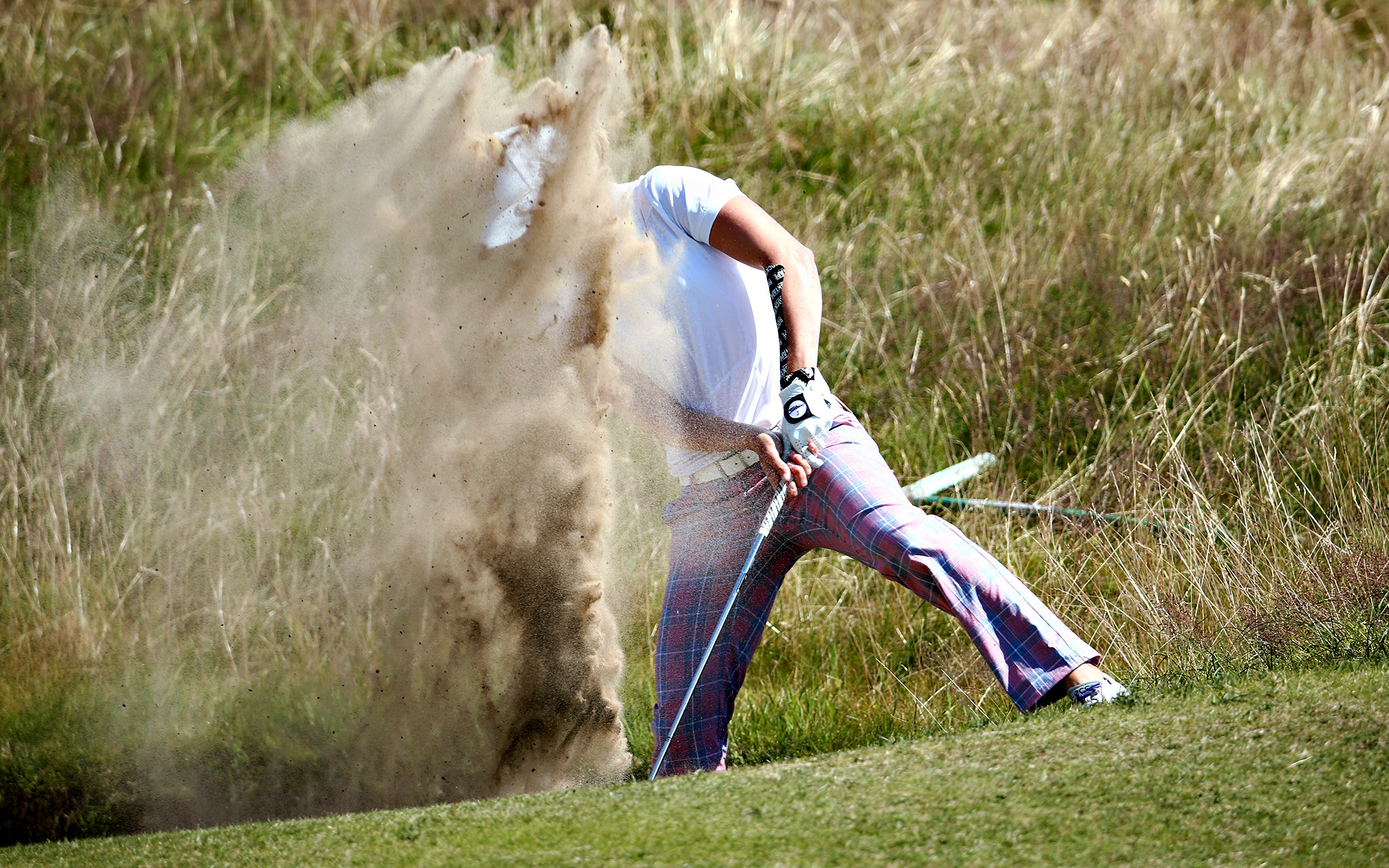 Brittany Lang of the United States hits from a bunker on the 15th hole during the first round of the Ricoh Women's British Open at Royal Birkdale on in Southport, England.