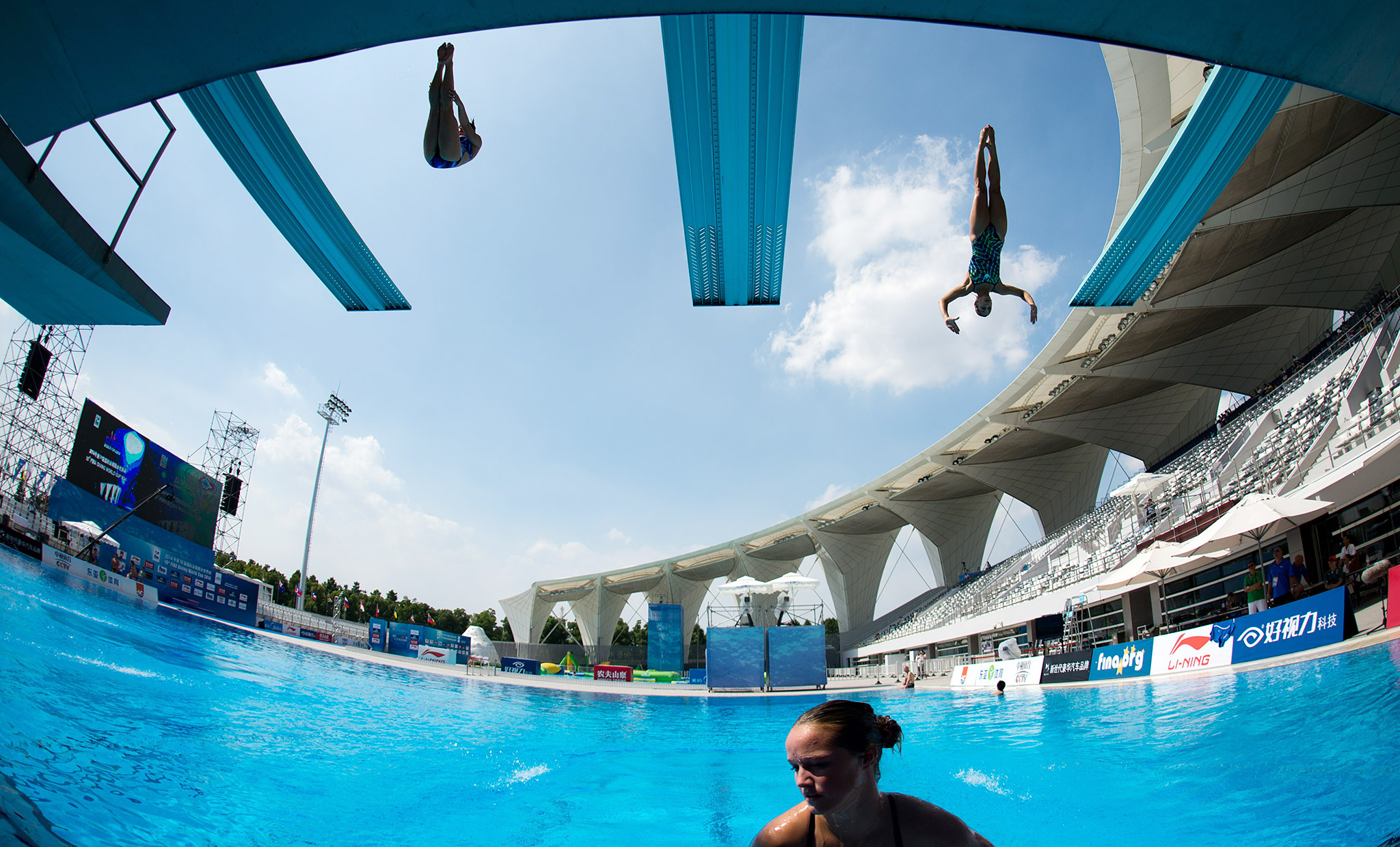 Athletes warm up during the women's 3-meter springboard final at the 19th FINA Diving World Cup in Shanghai.