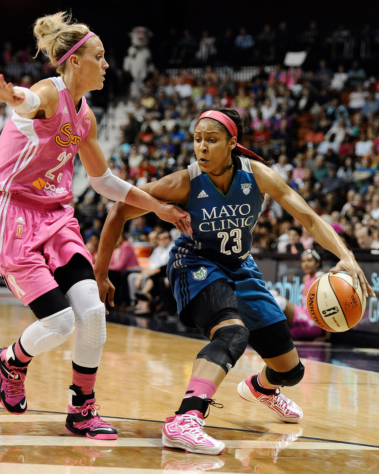 The Connecticut Sun's Katie Douglas guards the Minnesota Lynx's Maya Moore during their WNBA basketball game in Uncasville, Connecticut. Moore had 17 points, seven rebounds and four assists to help Minnesota beat Connecticut 76-65.