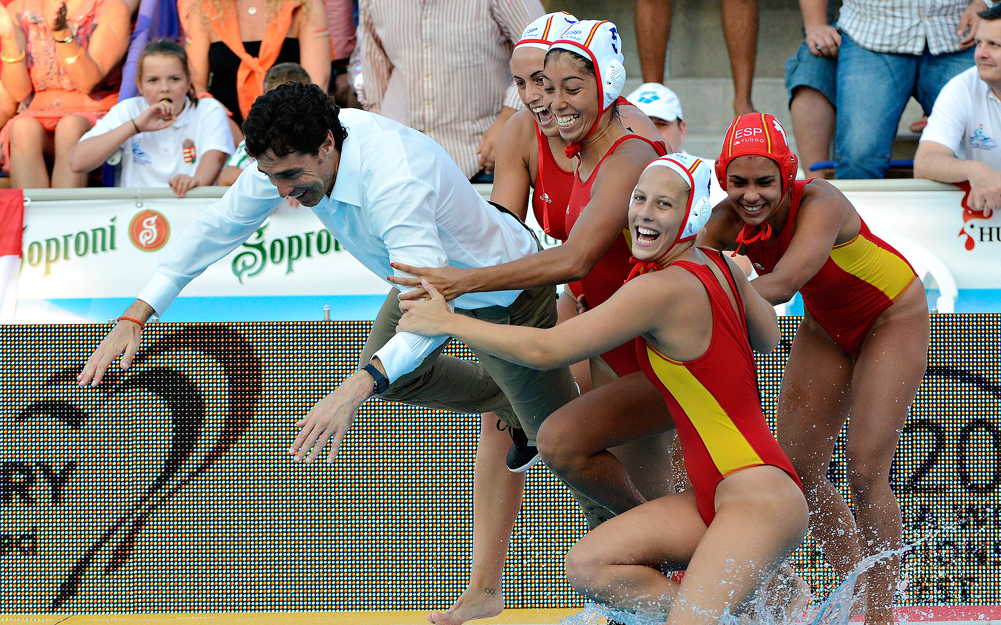 Spanish players throw their coach Miguel Oca into the pool as they celebrate their win over the Netherlands in the women's final at the European water polo championships in Hajos Alfred Swimming Pool in Budapest, Hungary.