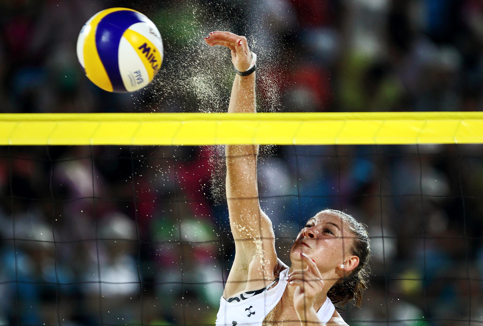 Dunja Gerson of Switzerland spikes the ball against the United States during the beach volleyball competition at the Nanjing Youth Olympic Games in China.