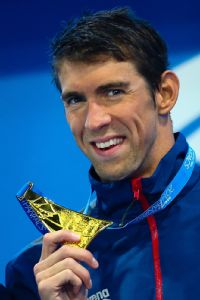 Michael Phelps won the gold medal in the 100-meter butterfly Saturday at the Pan Pacific championships, his first title since returning to individual competition earlier this year.
