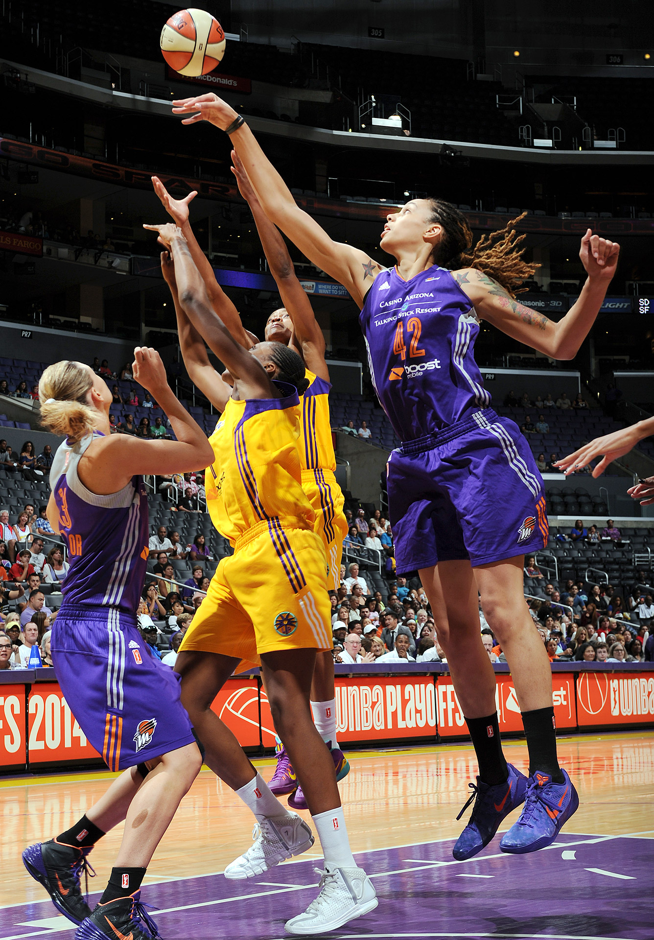 Brittney Griner scored 21 points -- including a rousing breakaway dunk -- as Phoenix completed a sweep over the Los Angeles Sparks in the Western Conference semifinals.