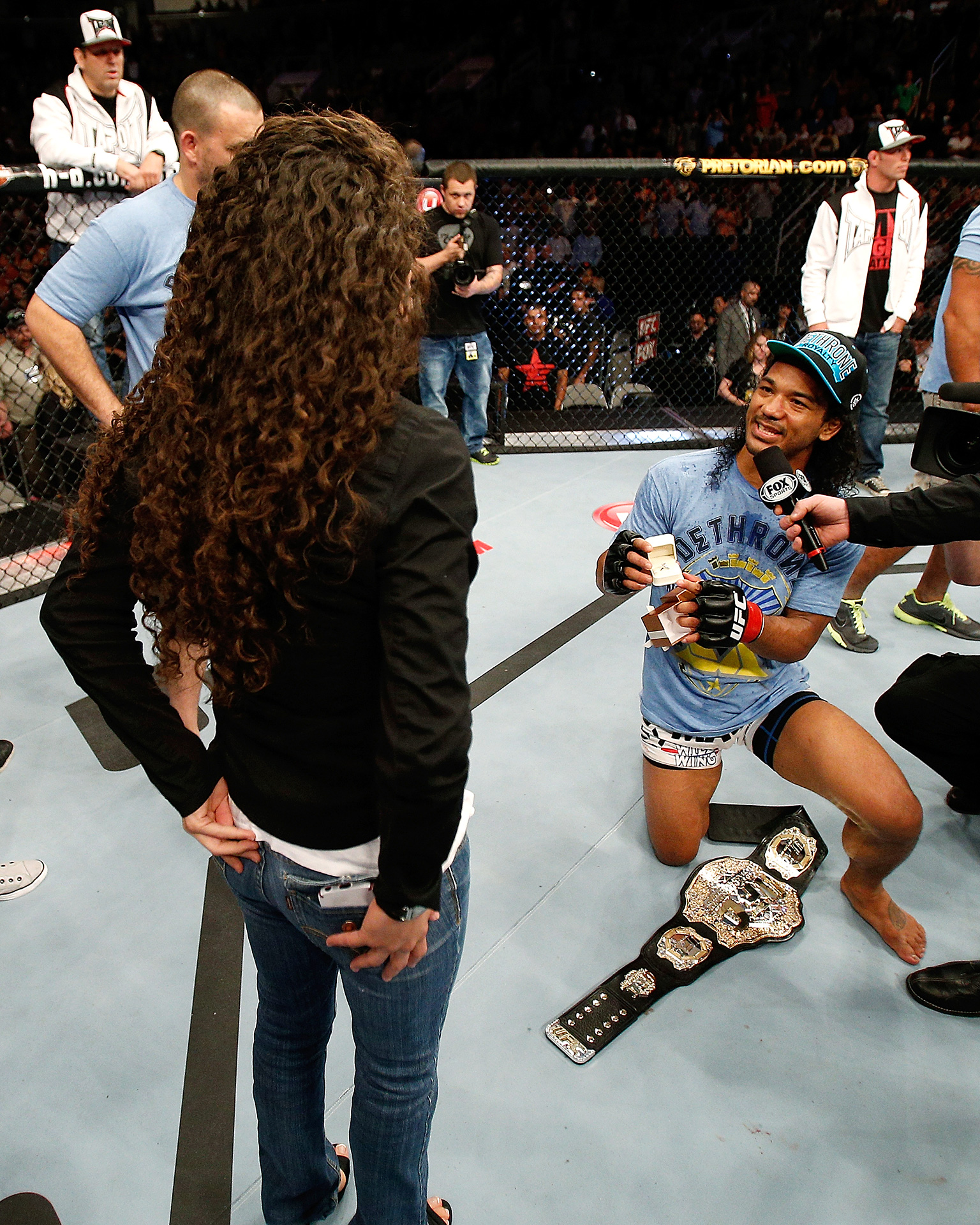 After defending his UFC lightweight title in April of 2013, Benson Henderson opted out of the traditional postfight interview and instead asked his girlfriend Maria Magana to marry him.