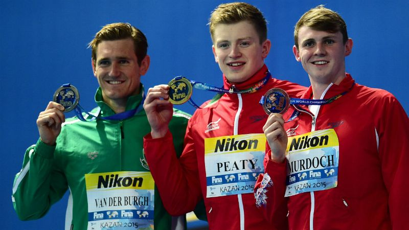 Adam Peaty poses with his 100m breaststroke gold medal at the Aquatics World Championships