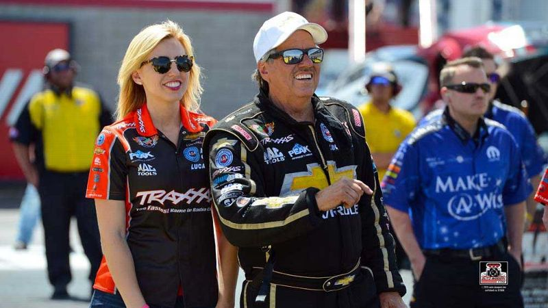 Courtney Force stands with her father, NHRA legend John Force, at the SummitRacing.com Nationals in Norwalk, Ohio, last year.