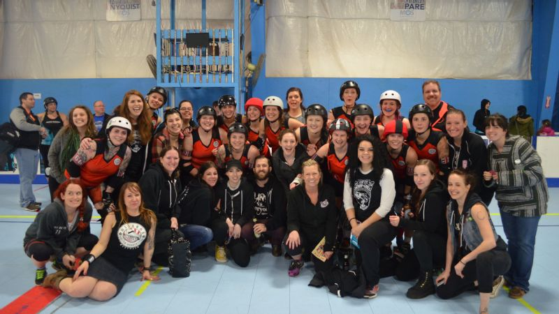 The Flint City Derby Girls pose with the Nidaros Roller Derby team from Trondheim, Norway, on April 9 at the Rivertown Sports Complex, Grand Rapids, Michigan.