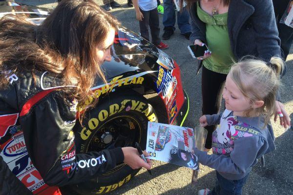 Julia Landauer signs an autograph for a young fan at Orange Show Speedway in San Bernardino, California.