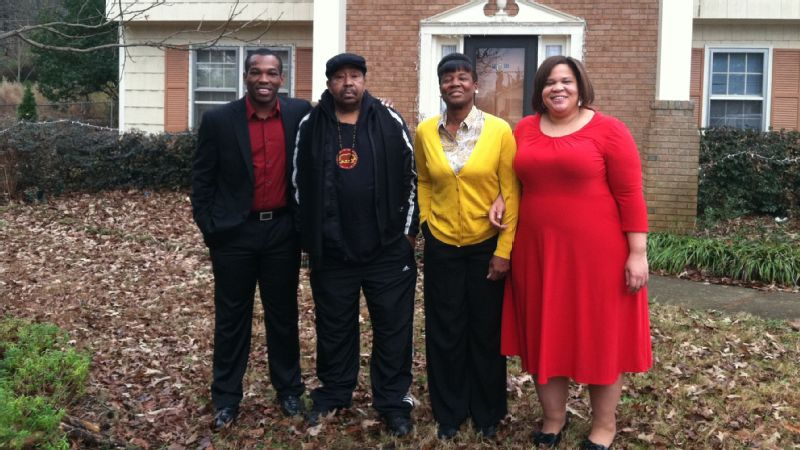 Nicholas Graham, Dennis Graham Jr, Melinda Graham and Latria Graham in front of the family home on Christmas Day in 2012.