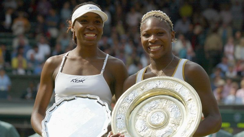Serena Williams celebrates with the trophy after her victory against Venus Williams at Wimbledon on July 6, 2002.
