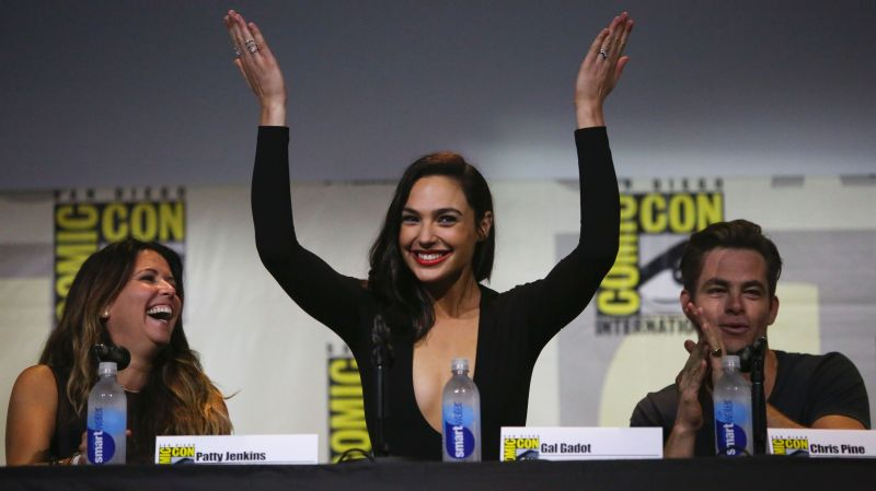 Actress Gal Gadot, who plays the title character in the film Wonder Woman, reacts to the crowd at Comic Con.