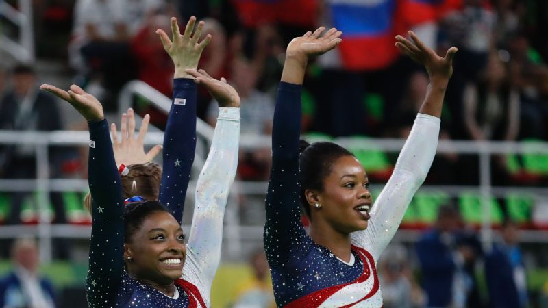 Simone Biles and Gabby Douglas celebrate after the team final in artistic gymnastics Aug. 9 at the Olympic Games in Rio de Janeiro.