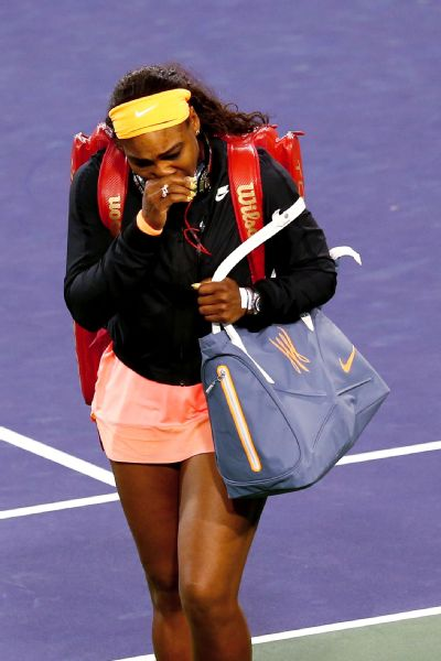 Serena Williams is overcome with emotion as she arrives on court at Indian Wells after a 13-year boycott.