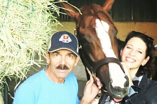 The Chromies are even fans of the racehorse's staff. Here, groom Raul Rodriguez poses with California Chrome and Robyn Cosio.