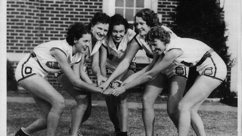 From left to right: OPC players La Homa Lassiter, Ernestine Lampson, Lucille Thurman, Hazel Vickers and Coral Worley huddle up before a game.