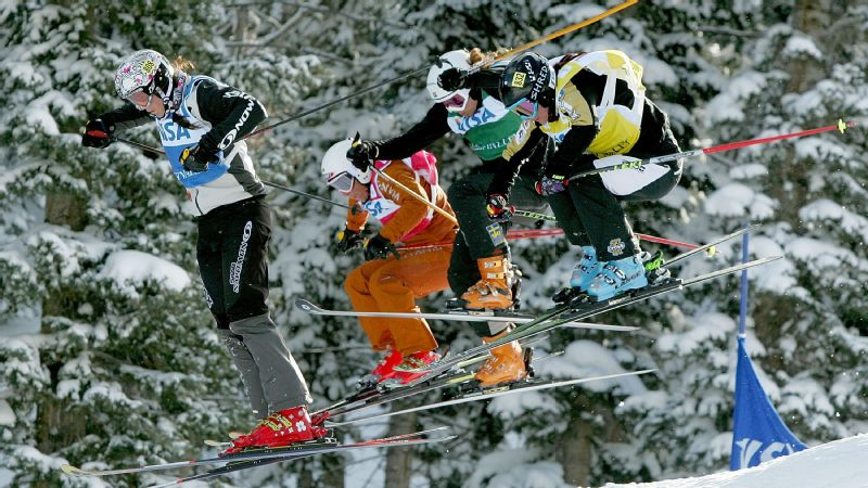 Concussions forced Anik Demers, second from left in orange, to retire from skicross in 2010.