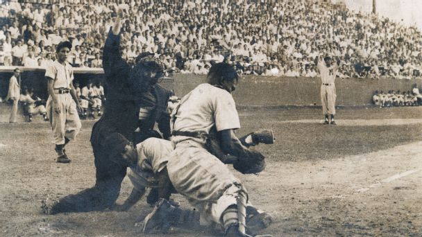 The Cienfuegos baseball team in action at Cerro Stadium in Havana, Cuba, in 1955.