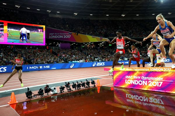 Race favorite Beatrice Chepkoech, far left, missed the water jump during the women's 3,000-meter steeplechase final, forcing her to backtrack and retry the jump. She finished fourth overall in the race.