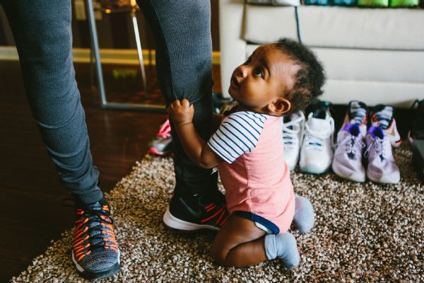 Bryson holds on to his mom while she sports Nike KD 9 Elite sneakers.