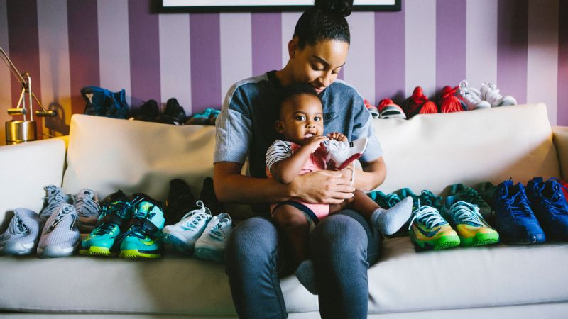 Bryson holds one of his Air Jordan 13 sneakers, while Hartley is surrounded by her collection of colorful kicks.