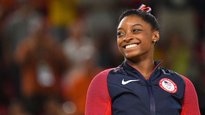 After more than a year off from the sport, Simone Biles will go back to official gymnastics training on November 1, with a new coach, Laurent Landi, who worked with Biles' Olympic teammate Madison Kocian.