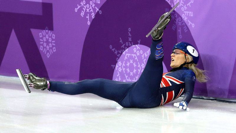 Elise Christie slides into the barrier after crashing out of the 500-meter short-track speedskating final, having set an Olympic record in her quarterfinal earlier in the day.