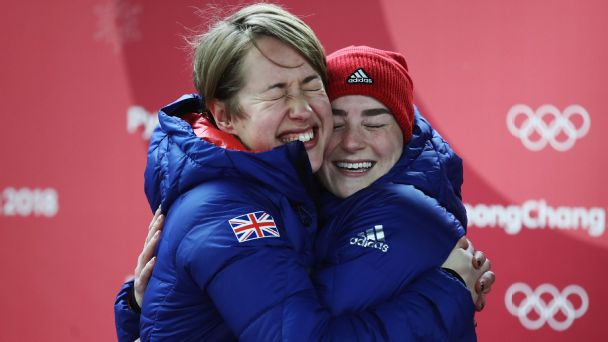 Lizzy Yarnold and Laura Deas celebrate winning gold and bronze, respectively, in the skeleton. Yarnold becomes the first Briton ever to win multiple Winter Olympic gold medals.