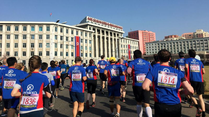 Runners hit the streets of Pyongyang in the early moments of the 2017 marathon. All foreign runners are classified as amateurs and are ranked separately from the elite North Korean runners.