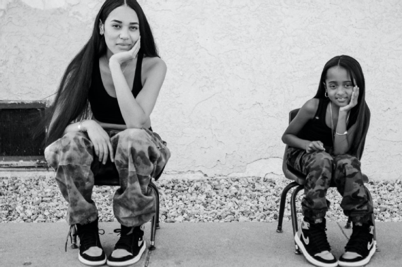 Aleali May and family friend Verniya wearing Nike Air Jordan 1s.