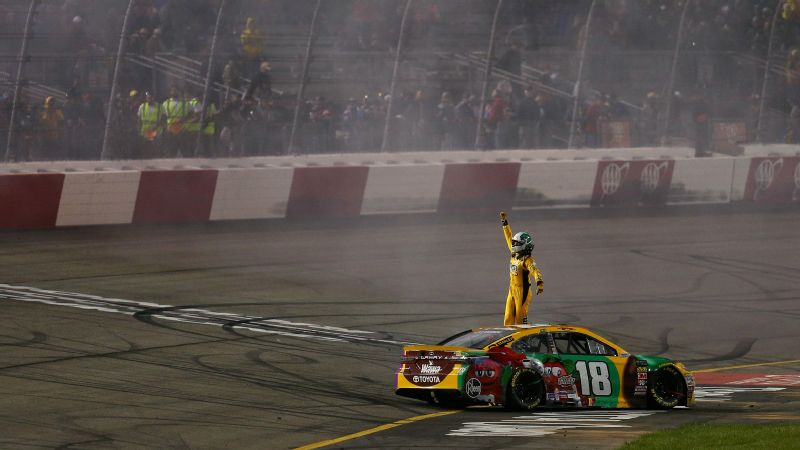 Kyle Busch, driver of the #18 M&M's Flavor Vote Toyota, celebrates after winning the Monster Energy NASCAR Cup Series Toyota Owners 400 at Richmond Raceway on April 21, 2018 in Richmond, Virginia.