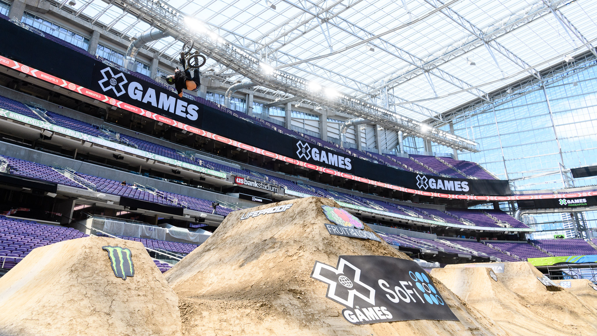 An unknown shredder tests out the BMX Dirt jumps on Tuesday of X Games week.