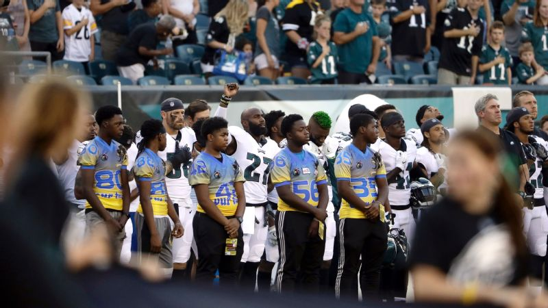 Eagles safety Malcom Jenkins raises his fist during the playing of the national anthem prior to Thursday night's preseason games against the Pittsburgh Steelers.