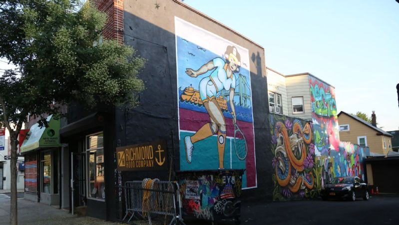 While the entire project took over two years, Jeremy Nieves needed just a month to paint the mural onto the wall of the Richmond Hood Company -- about two miles away from where the first tennis match on American soil took place.