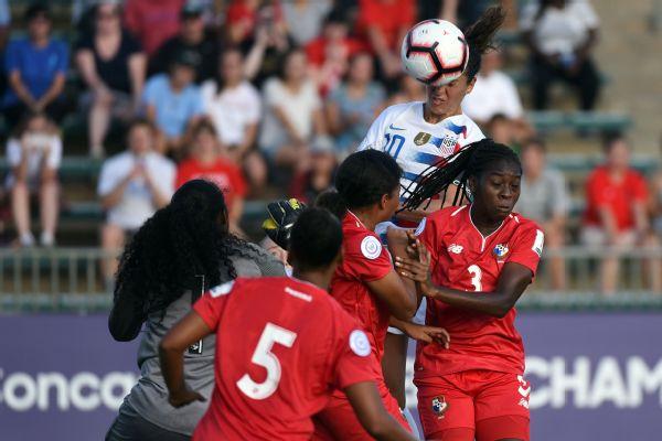 Carli Lloyd heads home one of her three goals against Panama.