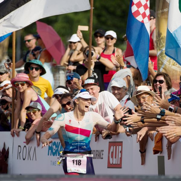 Charles receives congratulations as she heads down the home stretch of the 2017 Ironman world championships.