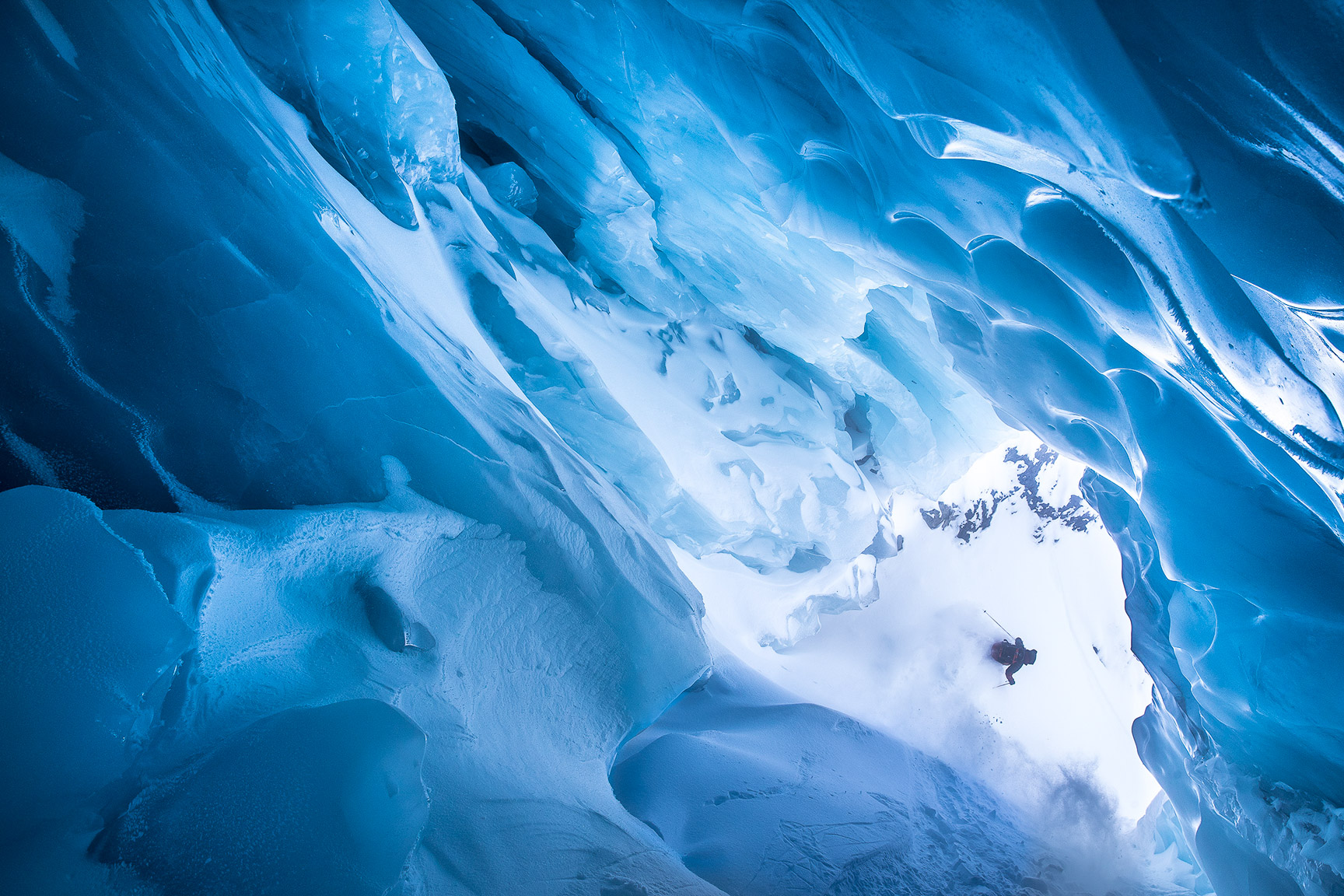 After a hot summer with a lot of melting, this ice cave opened up big enough last season to ski through. Getting this shot of Santiago was my first and last time in it. This summer it caved in and is there no more. -- Oskar Enander