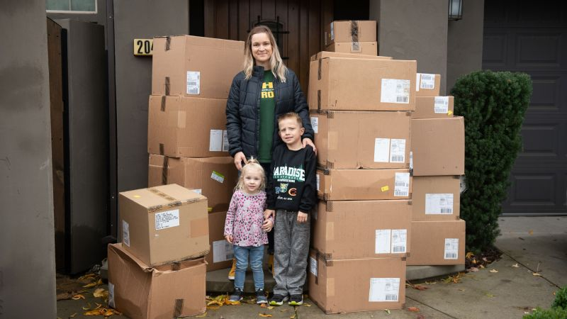 Anne Stearns with her kids and boxes of some of the donations that have been sent to Paradise.