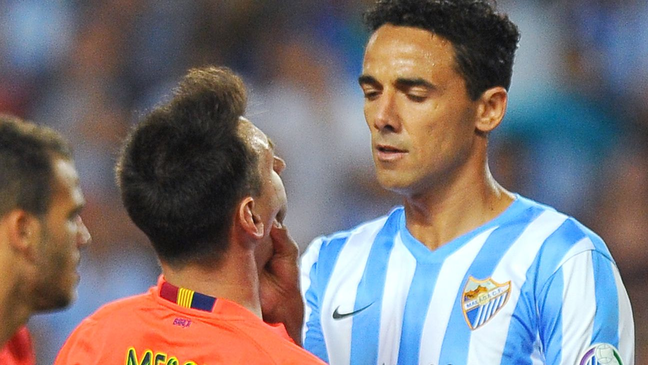 Malaga Defender Weligton Grabs Lionel Messi S Throat