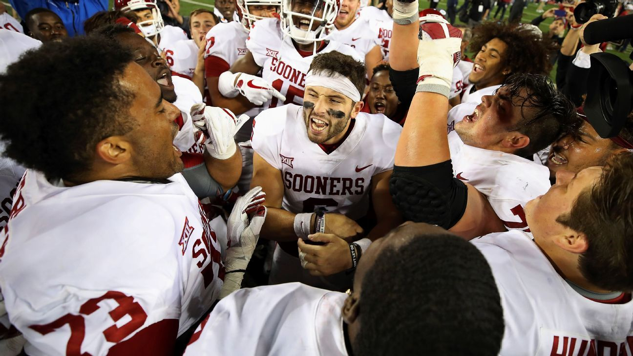 d58ddb99bb0 Baker Mayfield plants Oklahoma Sooners flag at midfield after beating Ohio  State Buckeyes