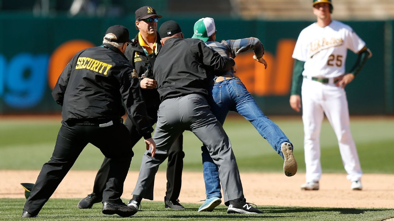 Ump tackles fan who ran onto field in Jays-A's