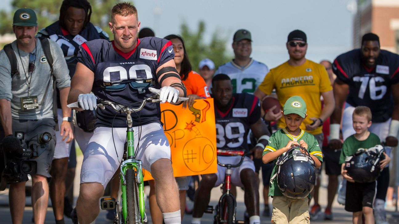 Best of Monday at NFL training camps: Breaking bikes and naming rights