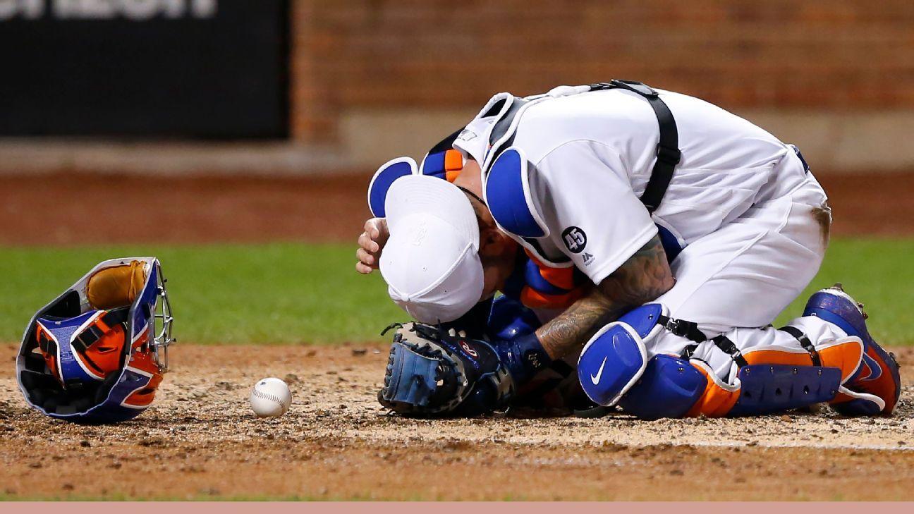 Mets C Nido exits after being hit in helmet by bat