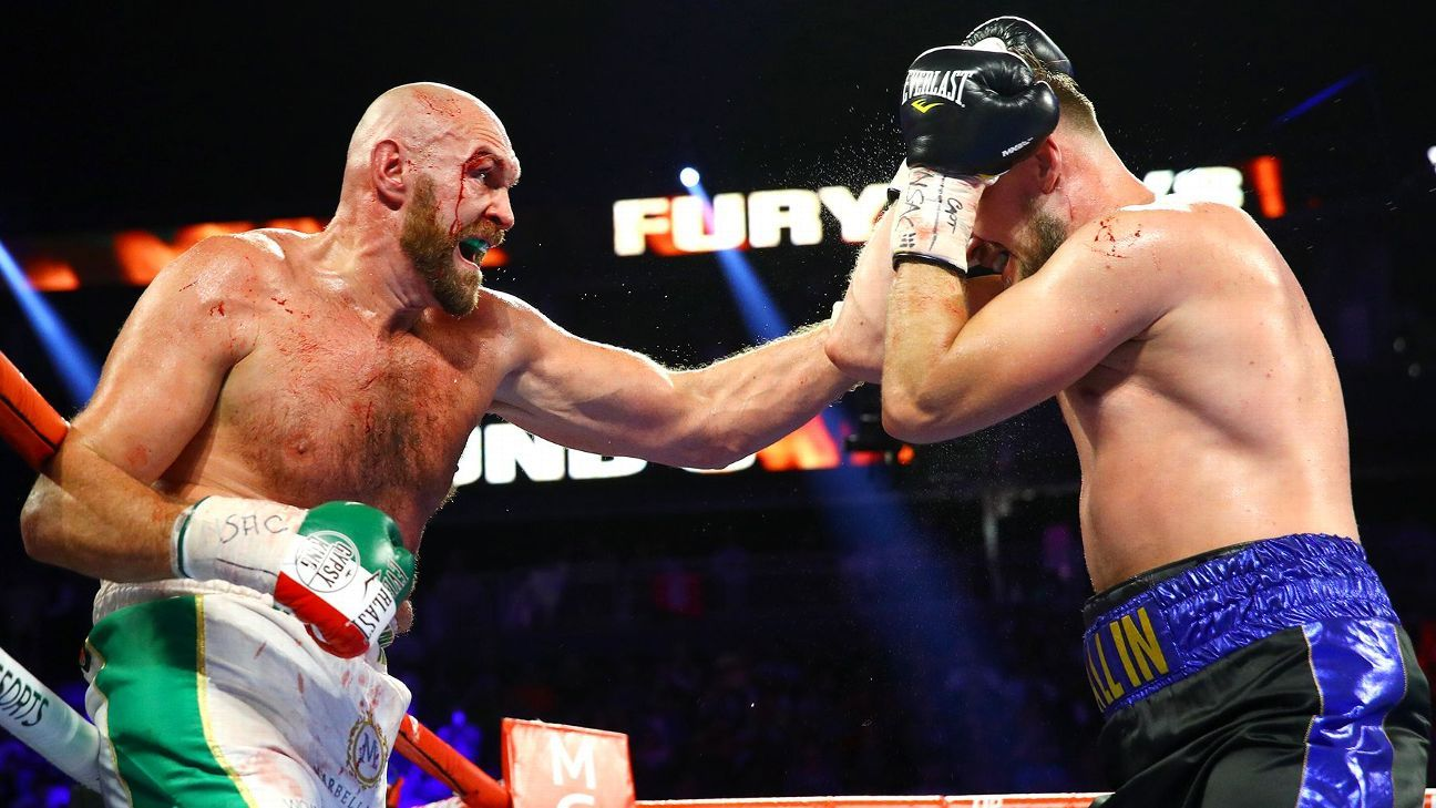 Fury survives cuts, grinds out win over Wallin