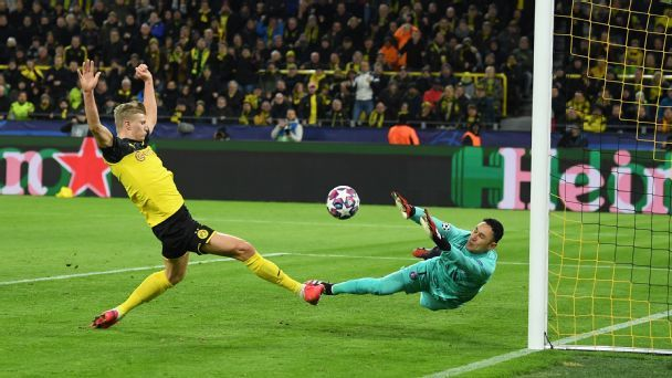 Record-setting Haaland leads Dortmund past PSG
