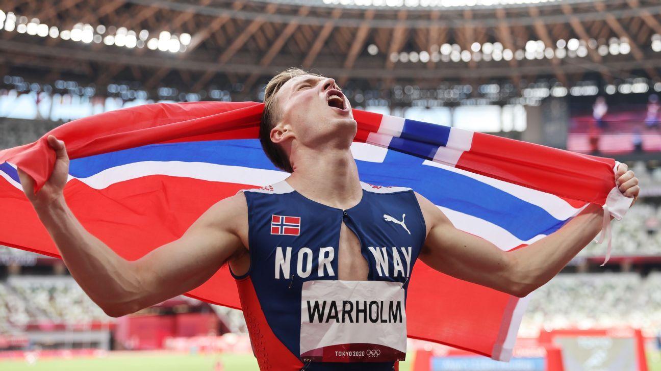 Norway's Karsten Warholm breaks his own world record, wins gold in 400-meter hurdles at Tokyo Olympics